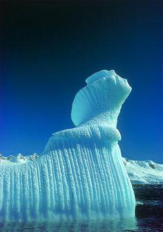 Spiral Iceberg in Paradise Bay. Antarctica. #travel