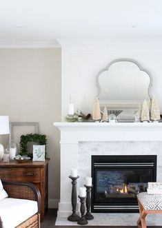 Come check out this winter wonderland themed fireplace, plus get fool-proof tips for putting together your own beautiful Christmas mantel! #ChristmasMantelDecor #WhiteChristmas