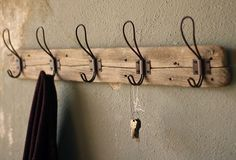 Reclaimed Wood Coat Rack - Give your foyer or bathroom a genuine farmhouse feel with our Recycled Wood Coat Rack with gorgeous vintage metal hooks. These 5 hooks will hold coats, scarves, towels or robes to perfection. Or switch it up and hang photo frames or trinkets from the hooks!