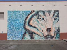 Husky handprint mural for Marguerite Elementary School in Alhambra. Artist, Nathanial Mauden handprints contributed by the entire student body and faculty of the school.
