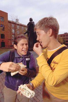 students eating fish tacos at the burro