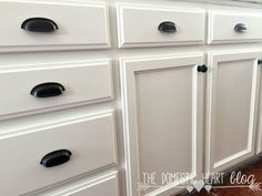 white kitchen cabinets close up with black drawer half moon drawer pulls