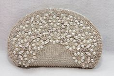 Purse is meticulously hand-sewn and embellished with only the finest beads, pearls and crystals.
