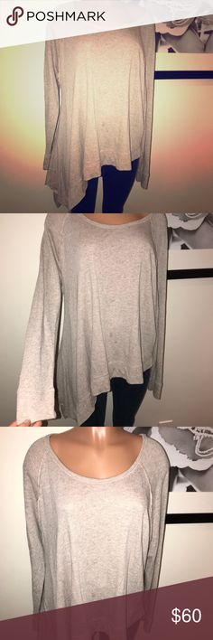 Sweatshirt w/slanted extra material on one side FREE PEOPLE 🔹medium 🔹scoop neck, inside out seams showing- that's the look of it- lots of extra fabric hangs down on one side, shorter & normal other side 😁 color: grey/pinkish color🔹EUC Free People Tops Sweatshirts & Hoodies