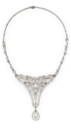 A Belle Epoque Platinum and Diamond Necklace-Brooch Combination, Circa 1910. Of openwork design with floral and foliate motifs, the front set with one old European-cut diamond weighing approximately 1.50 carats, suspending a pear-shaped diamond drop weighing approximately 1.50 carats, accented throughout with numerous old European, rose, and single-cut diamonds weighing approximately 10.75 carats, length 15 inches, the chain detaches so the front may be worn as a brooch. #BelleÉpoque