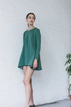 31daf153c8 Our Sunday Swing dress is made of organic cotton sweat jersey in jungle  green and has