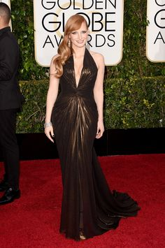 Jessica gave us disco fever in this Versace halter gown.
