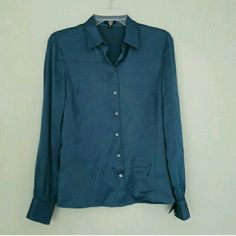 Ann Taylor Teal Blouse -Rich dark teal color -Silky fabric (91% silk ; 9% spandex)  -Great for work, paired with black pants or khakis!  -Flattering style, lightweight material. -Blouse button down Ann Taylor Tops Button Down Shirts