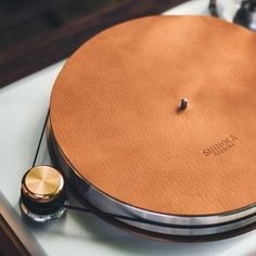 The Rose Gold Runwell Turntable has been designed inside and out for the discriminating audiophile and easy to use by any music enthusiast. Featuring a built-in phono preamplifier and a belt -driven pulley with speeds of 33 1/3 rpm and 45rpm, it's a 100% USA-made piece that will spin your vinyls in style.