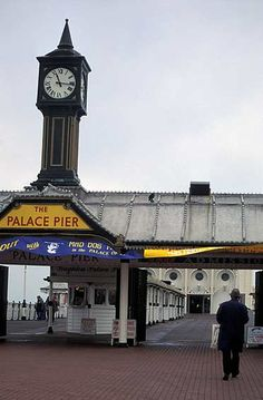 Palace Pier, Brighton entrance (before the owners changed the sign to Brighton Pier in 2000, an informal name change not recognised by the National Piers Society or many Brightonians). The full name of the pier is 'Brighton Marine and Palace Pier'