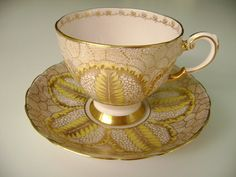 Art deco tuscan pink teacup and saucer feather by TorontoTreasures