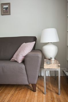 the nest. a one-bedroom apartment redesign in halifax, ns. the living room. custom end table. lamp from ikea. sofa from eq3.