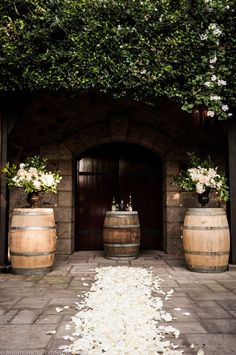 Ready for a courtyard ceremony. Love the wine barrels for this rustic chic wedding.   Photography by Bright Shot Photography