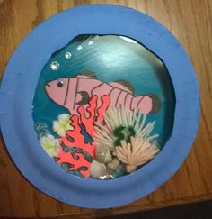 "Paper plate aquarium. Use this art activity to explore creatures and plants under the sea. ""Commotion in the Ocean"" by Giles Andreae is a great book to use with this activity."