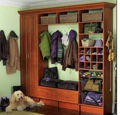 Mud room - kind of cluttered, but I like the tall cabinet on the right side - broom closet, perhaps?