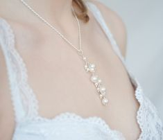 http://www.etsy.com/listing/86891609/bridal-necklace-pearl-pendant-wedding