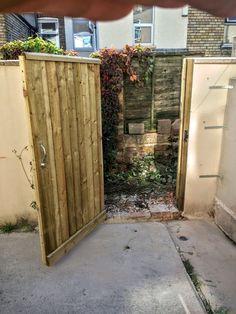 Garden gate installed in concrete block wall by PremFence in Bristol. Garden Fencing, Fence, Concrete Block Walls, Bristol, Building, Garden Fences, Buildings, Cinder Block Walls, Architectural Engineering