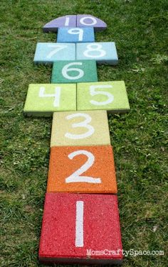 Super easy outdoor rainbow hopscotch - just use garden pavers and spray paint to add a fun splash of color to your yard! (Honest tip: use non-toxic, VOC free paint! But we have the hopscotch carpet still, remember? Backyard For Kids, Backyard Games, Lawn Games, Oasis Backyard, Backyard Landscaping, Landscaping Ideas, Patio Ideas, Kids Yard, Backyard Seating