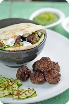 Lamb Koftas with grilled zucchini ribbons & coriander pesto in pita pockets- YUM! Easy Weekday Meals, Easy Meals, Indian Food Recipes, Healthy Recipes, Ethnic Recipes, Lamb Koftas, Cumin Lamb, Lamb Meatballs, Smitten Kitchen