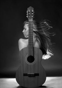 very cool! Girl with Guitar by Gabor Kanovits