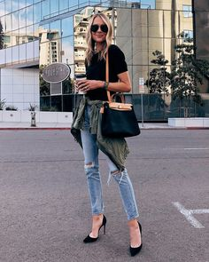 f52fdf2db Fashion Jackson Wearing Black Top Ripped Skinny Jeans Green Utility Jacket  Black Heels Hermes Herbag Green