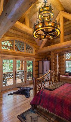 Log Home Bedroom. I love the patio off the bedroom. #LogHomeInteriors