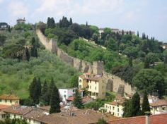 Tuscany, Italy (Florence) To ride a bike around Lucca, inside the wall, he'll, on the wall :)