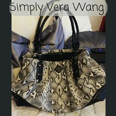 Vera Wang snake print purse bag Great condition .please look at last picture (a piece of discoloration on outside back of bag, not noticeable at all when wearing bag) very roomy, flexible, 3 large compartments. Magnetic button closure. 2 large zipper closure. No holes, tears or stains very clean bag inside. Simply Vera Vera Wang Bags Shoulder Bags