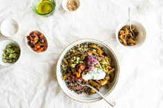 A Mung Quinoa Power Bowl - the base is simply mung beans and quinoa, and the magic comes from the deeply sautéed and spiced celery. It welcomes as many, or few, toppings as you like - roasted cherry tomatoes, salted dill yogurt, quick pickled red onions, chopped olives.