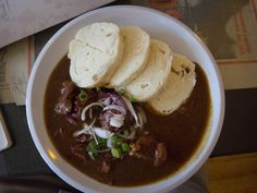 Czech Goulash & Bread Dumplings The goulash is easy. The dumplings are a bit of work to put together. You can chose to serve it with bread instead. Goulash Recipes, Beef Recipes, Soup Recipes, Cooking Recipes, Bread Dumplings Recipes, Dumpling Recipe, Eastern European Recipes, European Cuisine, Slovak Recipes