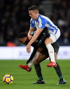Huddersfield's Jonathan Hogg climbs all over Manchester City's Raheem Sterling as City win 2-1 at the John Smith's Stadium.