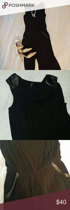 Black Cowl Neck Jumpsuit Chic black jumpsuit with sexy cowl neck and vegan leather shoulders. Also has vegan leather detailing at the pockets. Wide-legged palazzo pants finish the look! Only worn once, excellent condition! Milano Pants Jumpsuits & Rompers