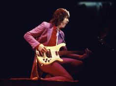 rock band performing 2015 | Chris Squire, in a 1979 photos plays his Rickenbacker bass during a ...