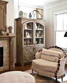 A beautiful French farmhouse style rustic armoire and chair