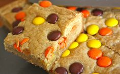 Easy Peasy Reese's Pieces Blondies ~ There are so many reasons to love this recipe: they take almost no time to make, their taste and texture appeals to the pickiest of palettes, they are inexpensive to make, they smell amazing when they are baking.. I could go on and on! Not only that but you probably have the ingredients for them in your kitchen right now. No pomp or circumstance needed! Just real butter, please but that should go without saying.