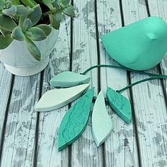 This geometric necklace is a beautiful blend of teal and mint with a minor marble blend as the feature. Made from air dry clay that is natural, eco friendly and handmade!! Sealed for water resistance.