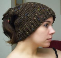 Crochet convertible hat--can be a cowl, a hat with a hole for your ponytail, or tighten the tie the top for a standard hat.  Free pattern!