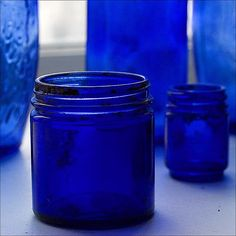 Just love blue jars in the window. My love. My hubby's pet peeve. Oh well. I keep them there anyway. lol