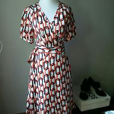 "Gorgeous sexy Banana Republic silk wrap dress Beautiful high quality silk fabrics,cute pattern,very good.condition,bust 18.5 "" waist 14"",,length 39"" Banana Republic Dresses Midi"