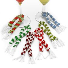 Keep your cocktail cozy and protected from those wandering holiday party winds also known affectionately as the  glass thief flurry.  Cute as a button and the perfect winter accessory, these wine charms...
