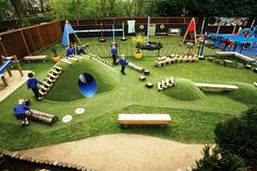I love the mounds obstacles in this outdoor play ground. Love the fake grass too...