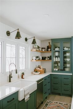 Kitchen Interior Design Green with envy - Straight to the inspiration files. That's what I thought when I saw this lovely farmhouse kitchen by Jaclyn Peters Design. The unusual grey green cabinets, vertical shiplap walls, the warm wood accent Dark Green Kitchen, Green Kitchen Cabinets, Farmhouse Kitchen Cabinets, Modern Farmhouse Kitchens, Home Kitchens, Kitchen Dining, Kitchen Backsplash, Kitchen Modern, Kitchen Fixtures