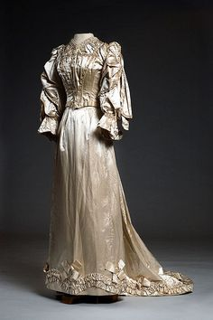 Cream satin wedding dress, 1891. Miss Lily Cheney wore this lovely dress when she married William Wallace Moore on December 20, 1891.  Via Charleston Museum, flickr.