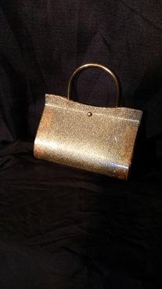vintage 50s acrylic gold glitter clutch evening bag purse pin up startlet handbag brass handle hinged bottom brass toggle closure by shopvaluablevintage on Etsy