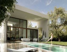 White with timber exteriors, perfect pool colour