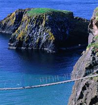 Carrick-a-Rede Rope Bridge sways along the Giant's Causeway in the United Kingdom. You have got to see this, but don't look down!