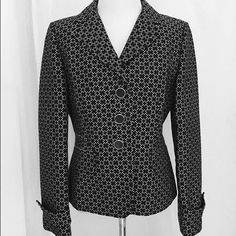 """Ann Taylor Black and White Jacket Stylish, yet professional jacket. It has a 3 button front closure, front pockets, button accents on the sleeves and a partial back belt secured with buttons. Fabric is 86% cotton and 14% silk. Sleeves measure 23"""" from shoulder to cuff and length is 23"""" from back top center to hemline. Worn once. Ann Taylor Jackets & Coats Blazers"""