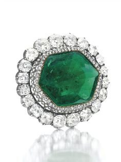 Commissioned by Catherine the Great, this brooch includes a 70 carat octagonal Columbian emerald, unique in terms of both quality and size, surrounded by two rows of rose cut diamonds.