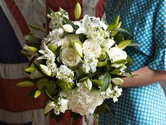 white wedding bouquet with lilies, roses and hydrangeas