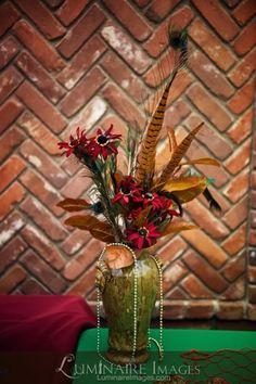 red flower arrangement for Pirate themed Halloween wedding